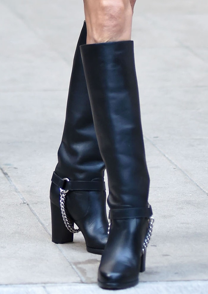 Celine Dion finishes off her look with black leather riding boots
