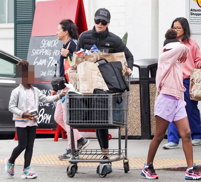 Charlize Theron is seen grocery shopping at Bristol Farms with her black African girls Jackson and August