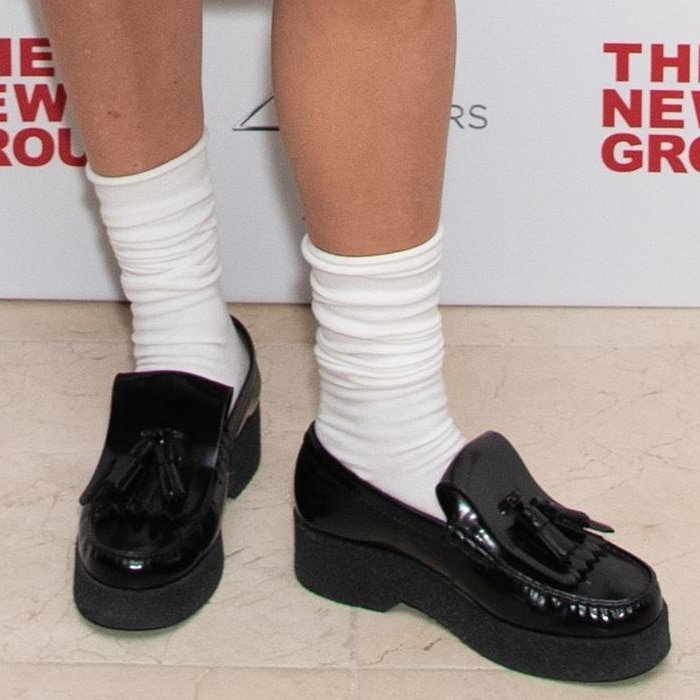Chloe Sevigny wears black loafers with white ankle socks