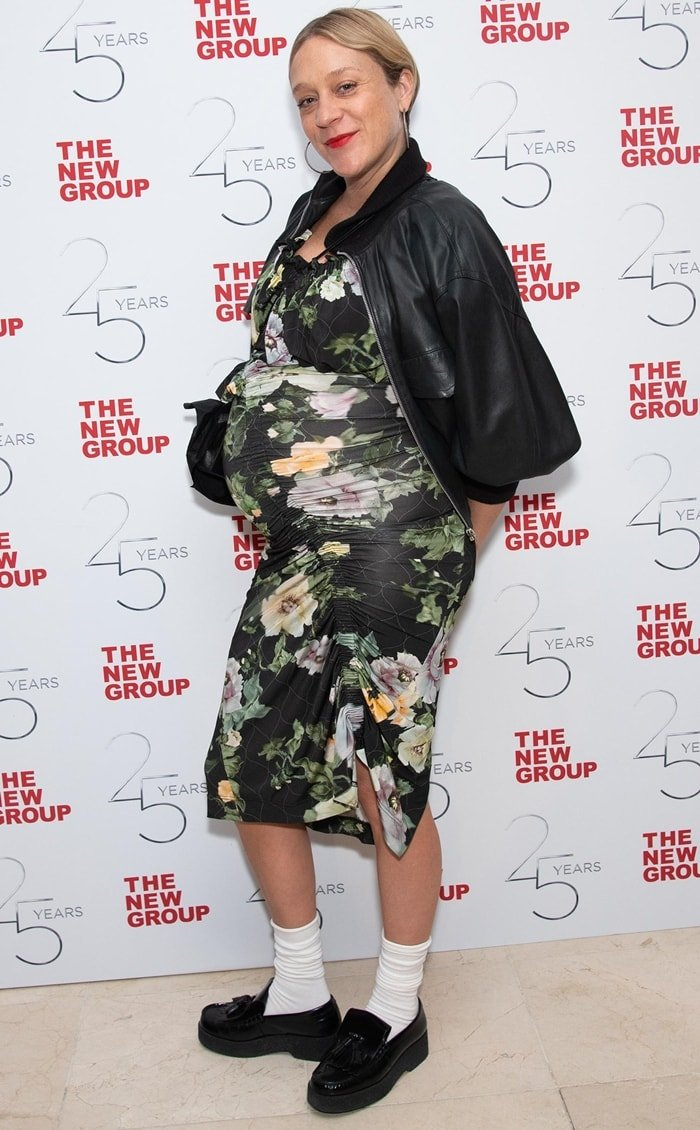 Chloe Sevigny wore a bomber jacket with a floral Preen dress