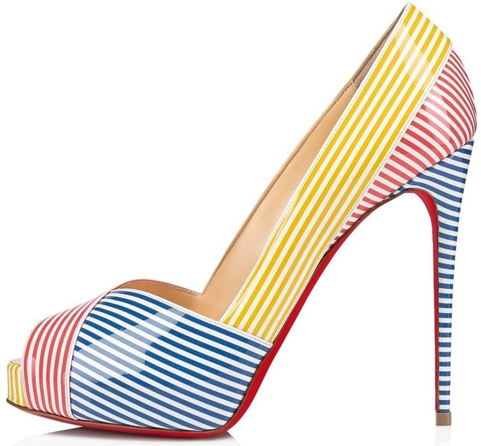 The stripes continue all over the shoe in blocks of different bright colours, like deckchairs on the beach