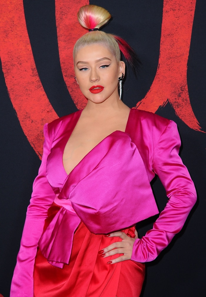Christina Aguilera accessorized with Stephen Webster's black Magnipheasant feathers long drop earrings that retail for $25,000