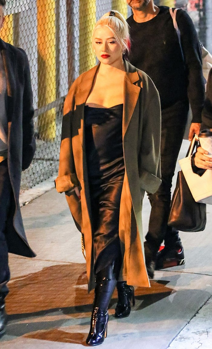 Christina Aguilera leaving Jimmy Kimmel Live studio in silky dress and long coat on March 10, 2020