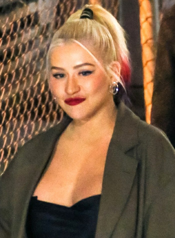 Christina Aguilera wears red lipstick and a high ponytail
