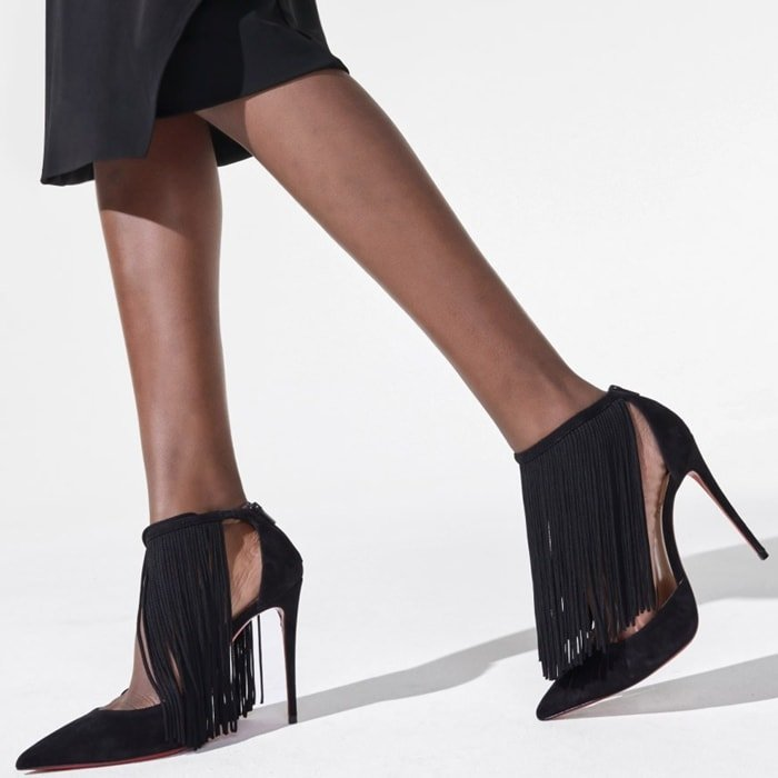 A dramatic curtain fringe redefines these classic suede pumps