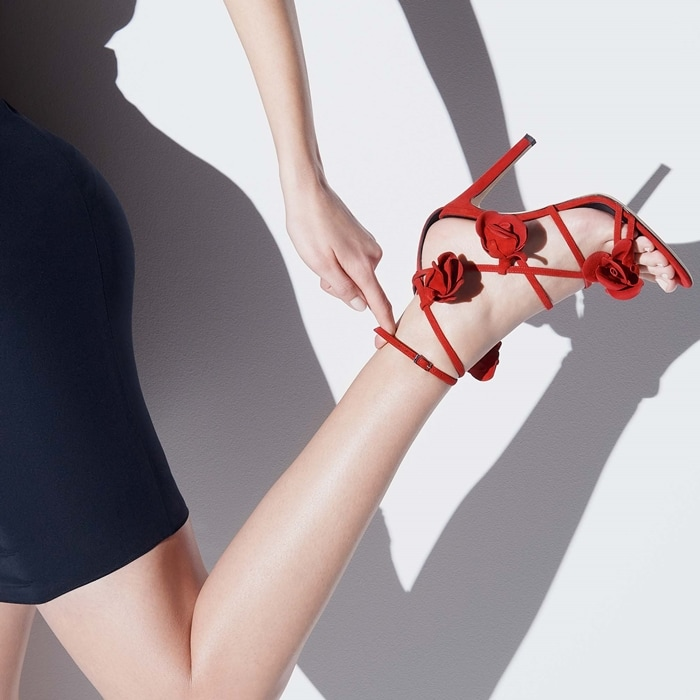Strappy red suede sandal with rose petal embellishment