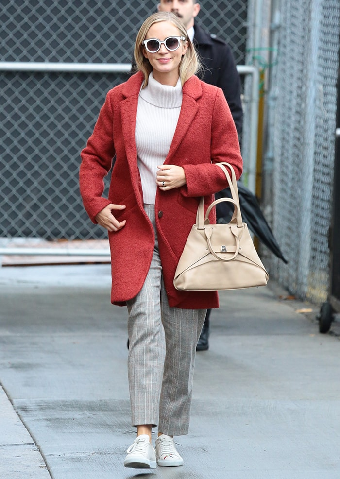 Emily Blunt bundles up in a turtleneck top and a red coat as she heads to Jimmy Kimmel Live taping on March 10, 2020