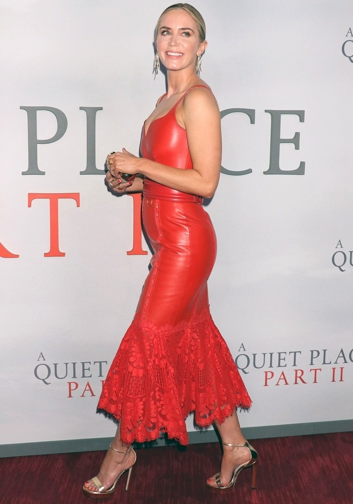 Emily Blunt rocks a red leather Alexander McQueen midi dress