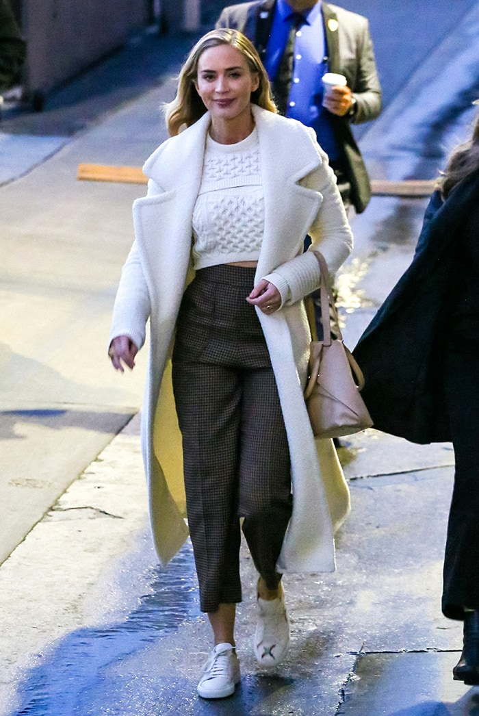 Emily Blunt leaving Jimmy Kimmel Live studios in white knit crop top and long coat
