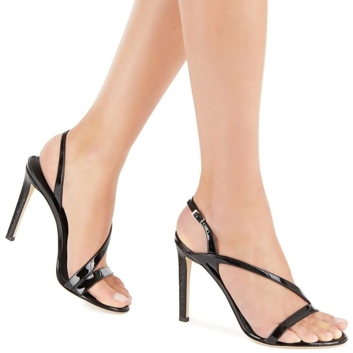 These high heel, patent black leather sandals feature a back strap in matching colour and a covered, python print black leather heel