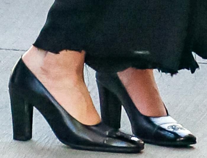 Grace VanderWaal completes her look with black Chanel pumps