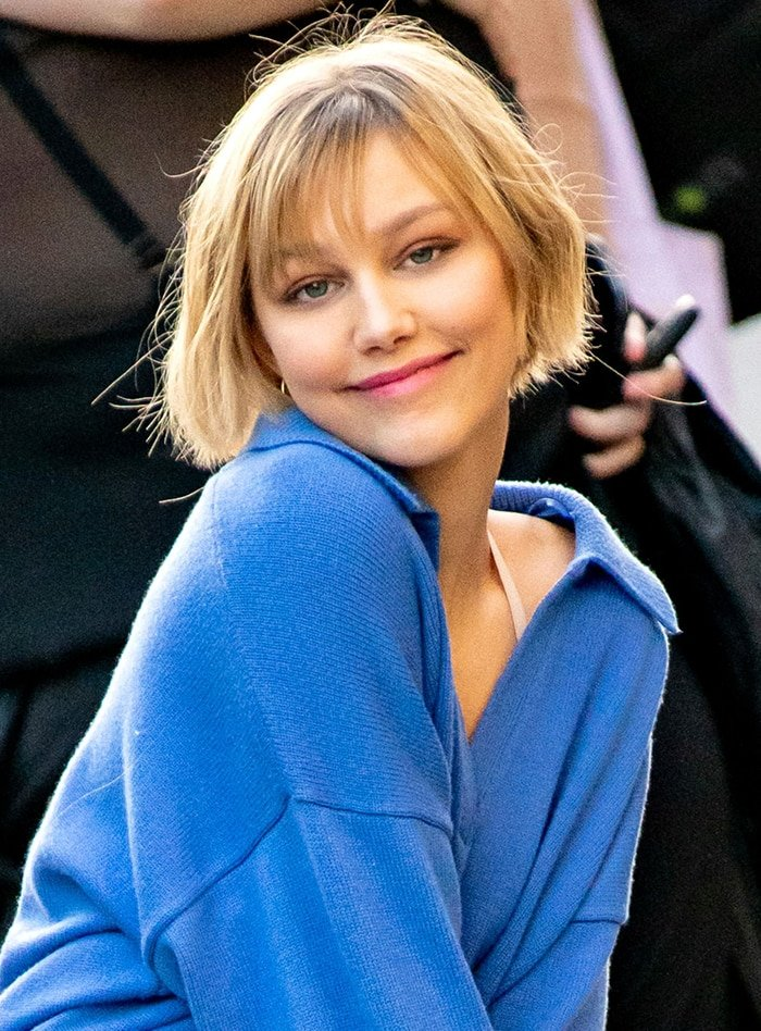 Grace VanderWaal wears her signature fringed bob hairstyle with light pink makeup