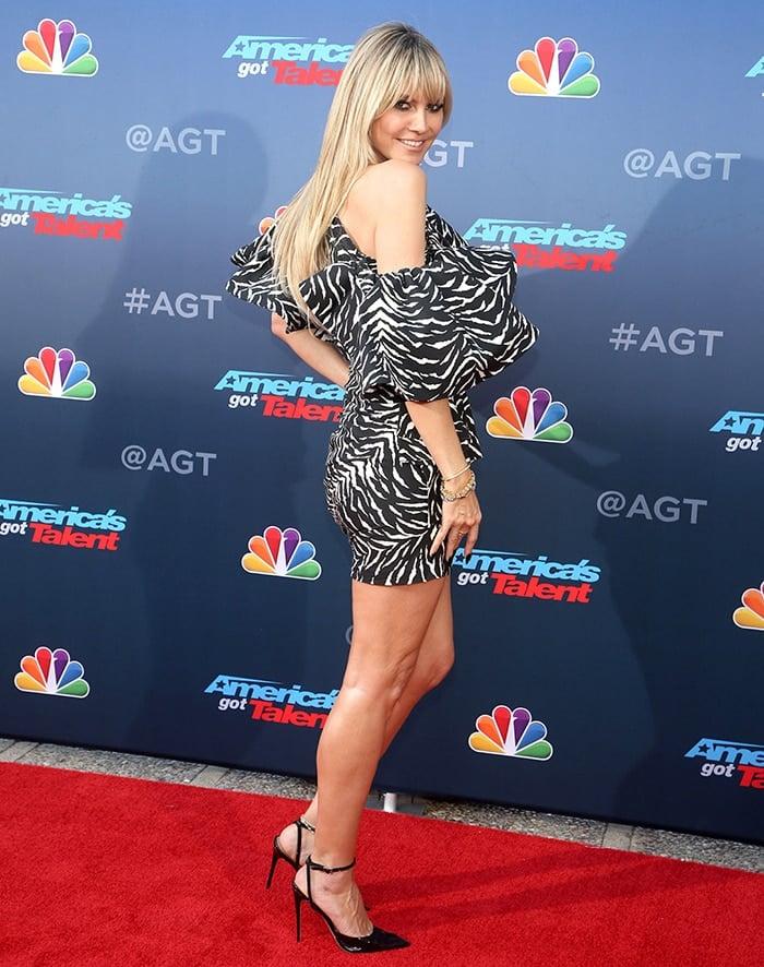 Heidi Klum showcases her insured legs in Redemption zebra-striped dress