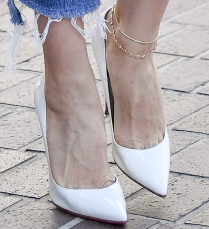 Heidi Klum completes her spring-ready look with Christian Louboutin white pumps