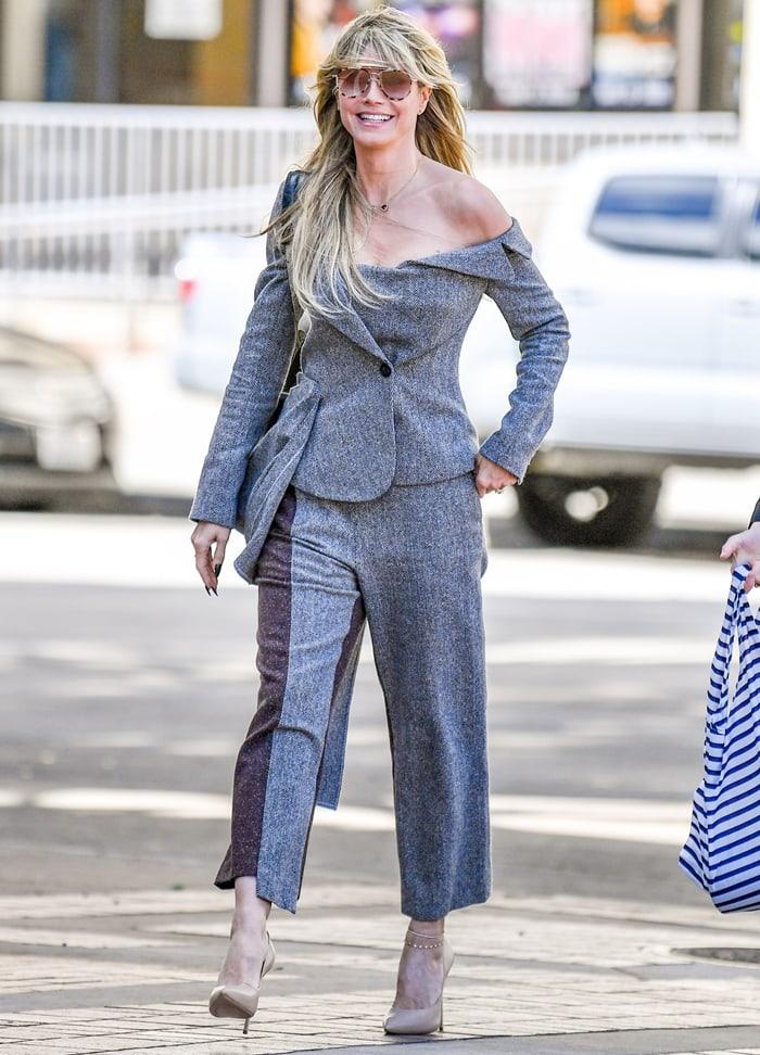 Heidi Klum rocks Monse deconstructed slim-fit trousers