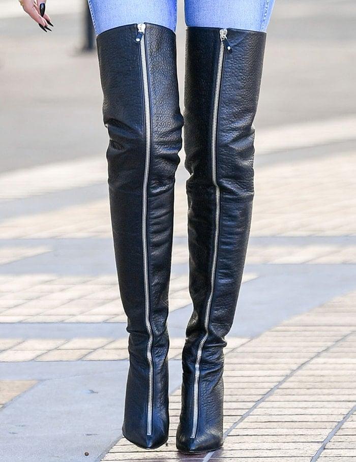 Heidi Klum wears a pair of leg-lengthening Monika Chiang thigh-high boots