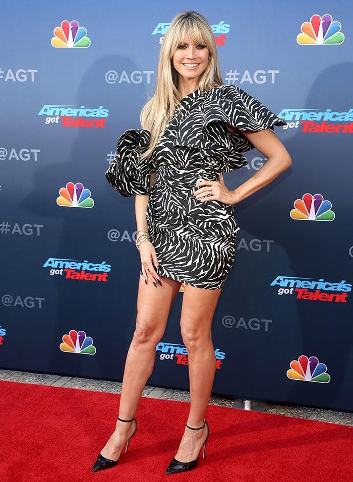 Heidi Klum returns to the judging panel for America's Got Talent Season 15