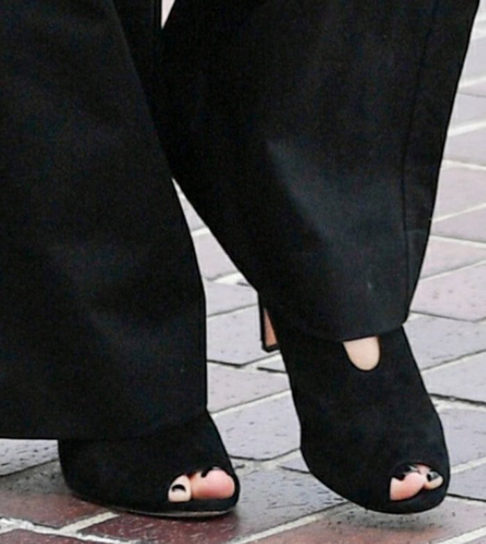 Heidi Klum teams her edgy utilitarian jumpsuit with Vince Camuto peep toe booties