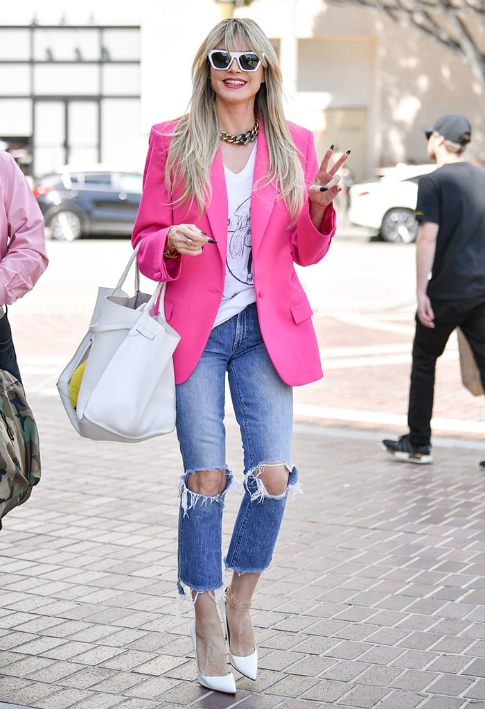 Heidi Klum heading to the AGT studio in neon pink blazer and jeans on March 8, 2020
