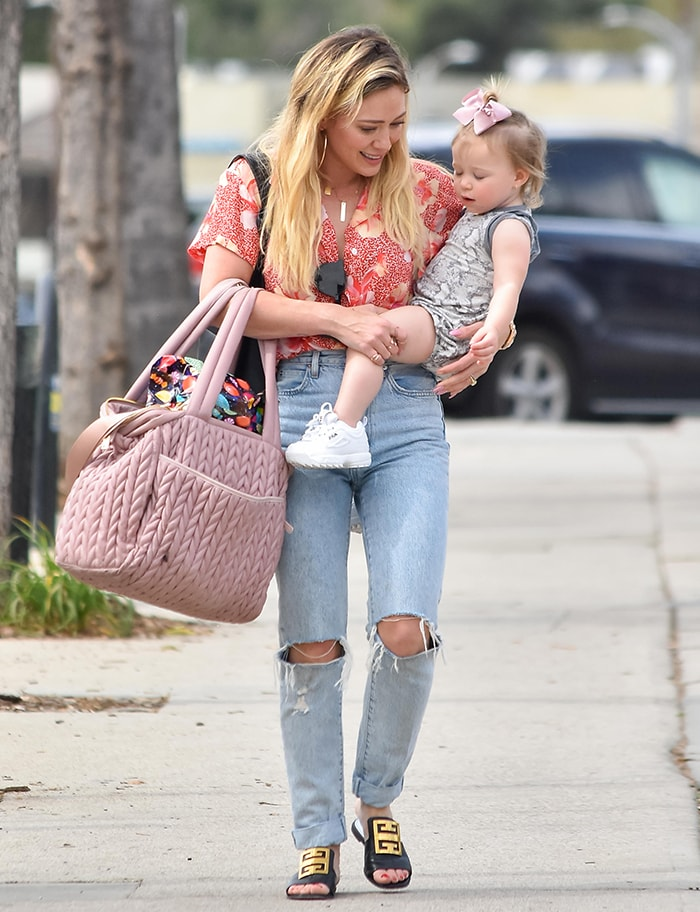 Hilary Duff steps out in Givenchy sandals with her daughter Banks Violet two days after shading Disney on February 27, 2020