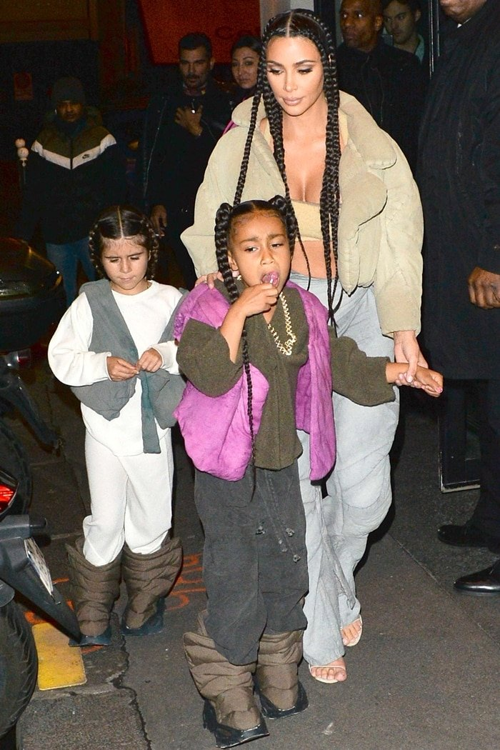 Kim Kardashian West, North West, and Penelope Scotland Disick wearing ridiculous outfit sin Paris