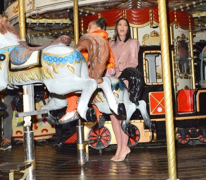Kim Kardashian and North West are seen on a carousel at the Eiffel Tower