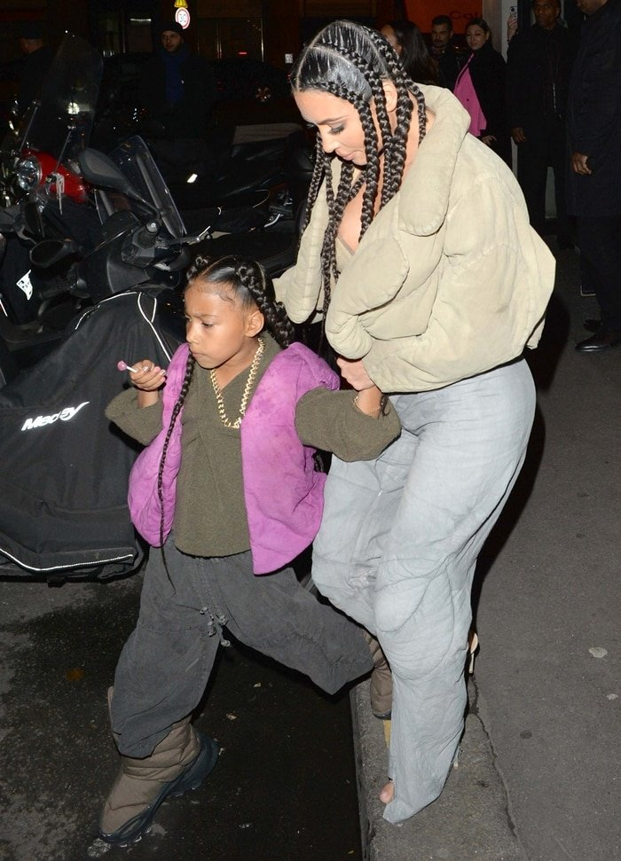 "Kim Kardashian West and daughter North West attend the ""Yeezy Season 8"" show"
