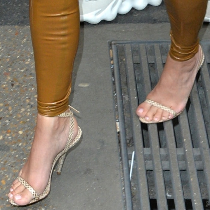 Kim Kardashian shows off her feet in ankle-strap sandals