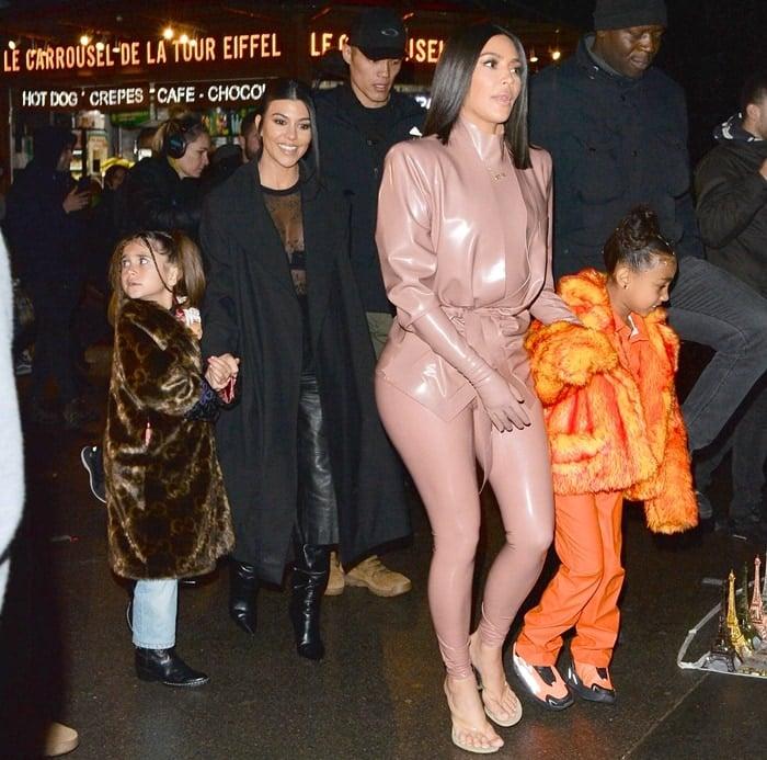 Kim Kardashian, North West, Penelope Disick, and Kourtney Kardashian enjoying an evening in Paris during the city's Fashion Week