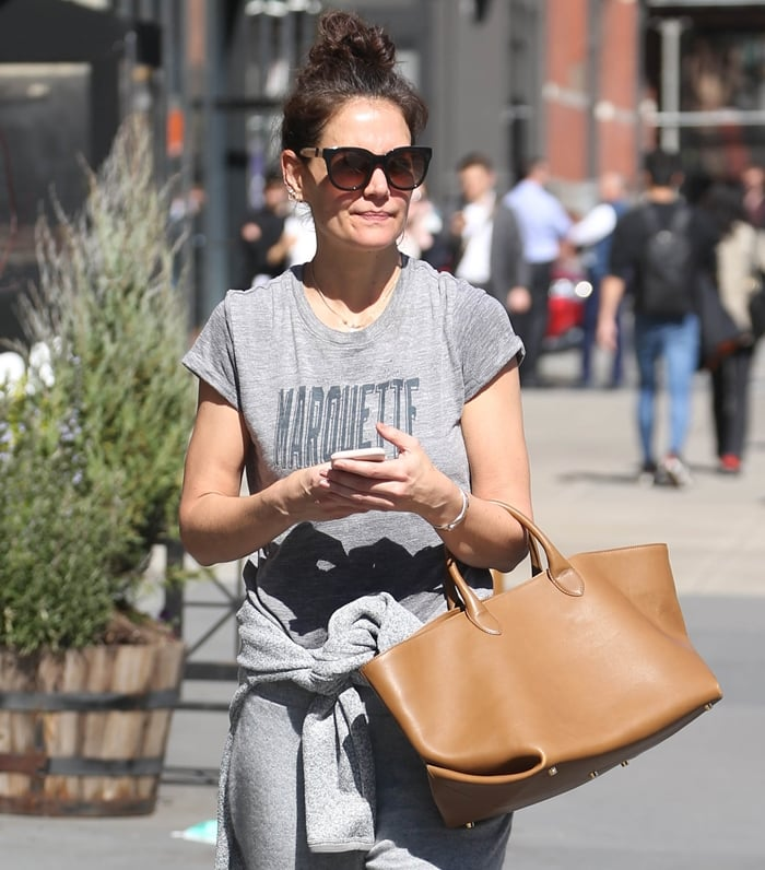 Make-up free Katie Holmes carrying a Khaite Envelope Pleat tote made in Italy from buttery caramel leather
