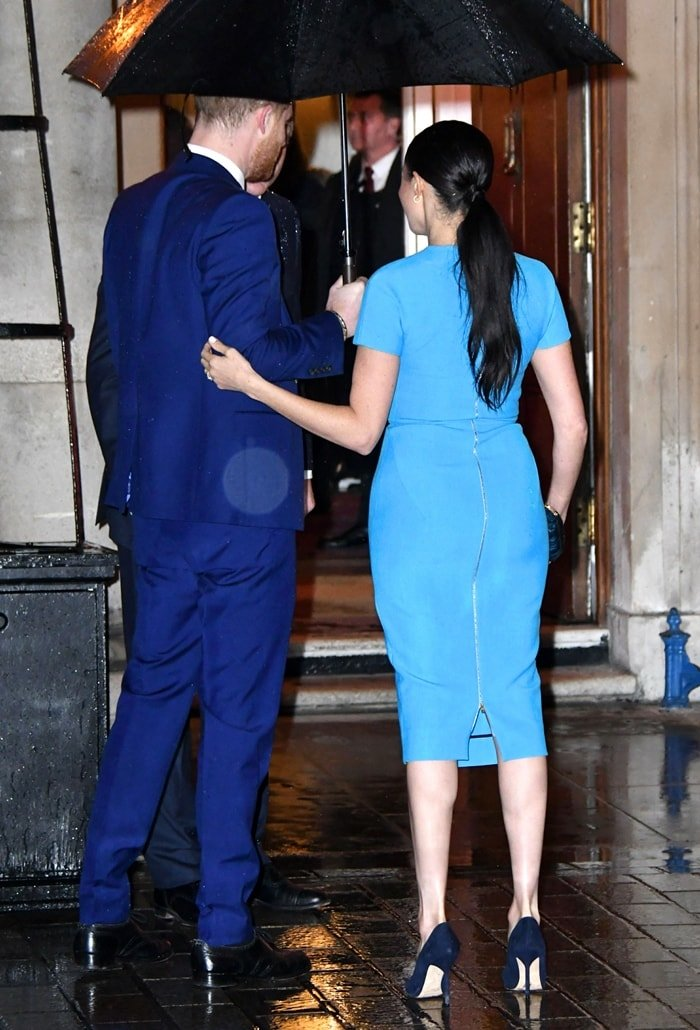Meghan Markle's turquoise blue midi dress is crafted from lightweight wool-blend crêpe