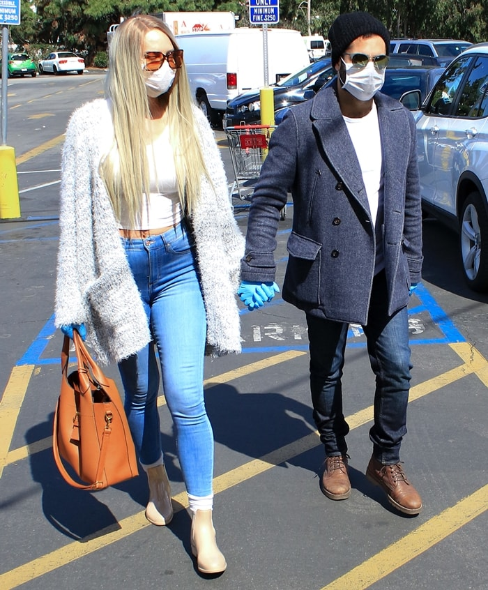 Natasha Alam and her boyfriend Justin Benjamin are seen wearing masks and surgical gloves