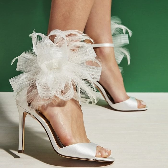 The Dalila sandal will ensure that you make an entrance with a two-piece silhouette, a large tulle bow with soft feathers at the side panel, and a wrapped stiletto heel