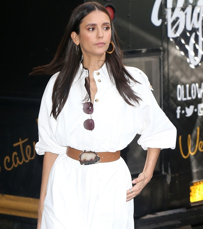 Actress Nina Dobrev wears a belted Gabriela Hearst dress inspired by the Kurdish Female Resistance