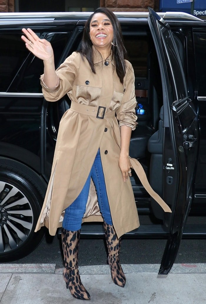 Regina Hall wears a dark khaki Icon belted trench coat on March 12, 2020, in New York City