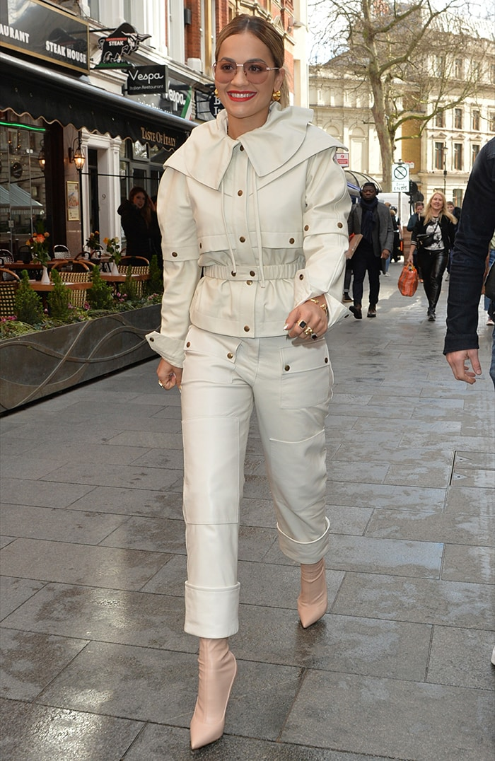 Rita Ora steps out in white utilitarian outfit ahead of her guest appearance on the Capital Breakfast on March 11, 2020