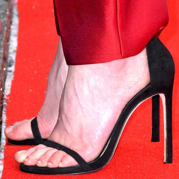 Rosamund Pike's hot feet in Stuart Weitzman sandals