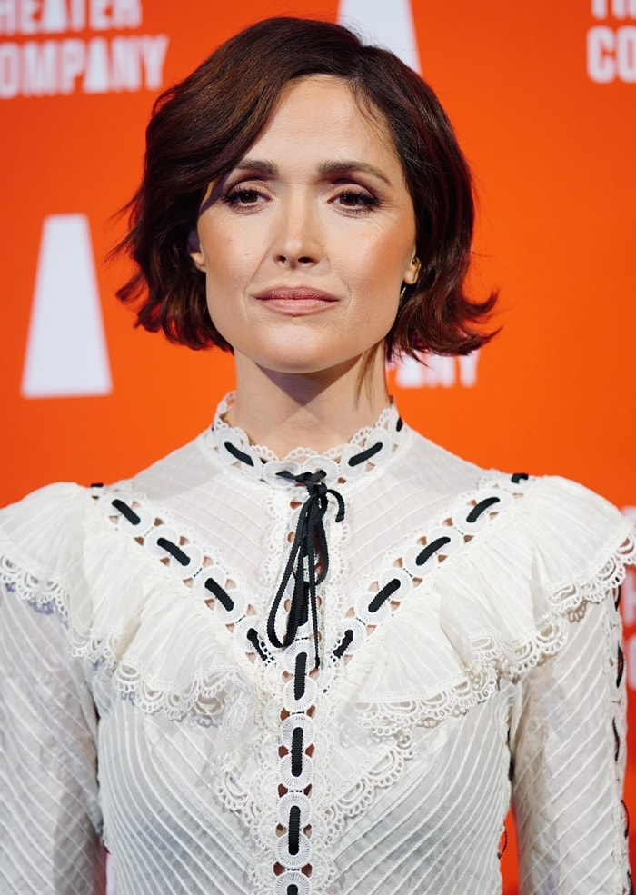 Rose Byrne's white pintuck blouse is defined by broderie-anglaise accents that are offset with black grosgrain ribbons for a charming flourish