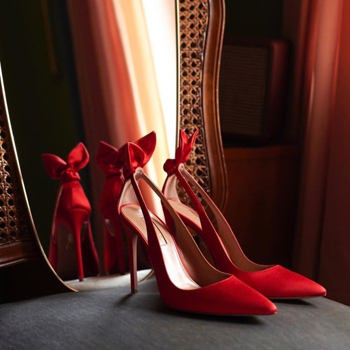 Start every ensemble on the right foot with Aquazzura's Deneuve pumps, which have been updated in a sensual lipstick-red satin