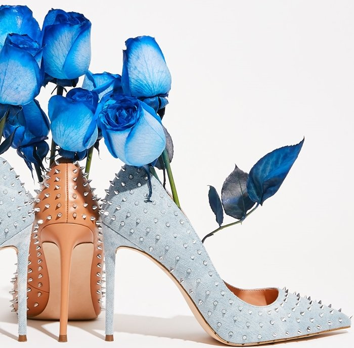 Spiky studs add rocker-chic attitude to a pointed-toe pump lifted by a stiletto heel