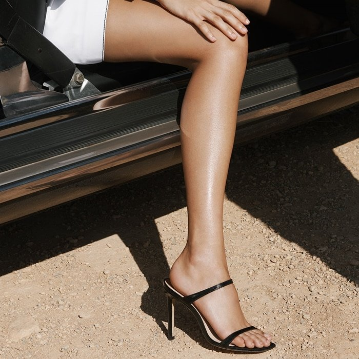 Strappy patent leather mules exude refined minimalism
