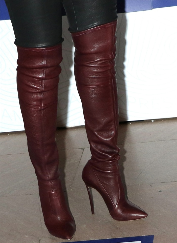 Taraji P. Henson in towering burgundy Casadei leather over-the-knee boots