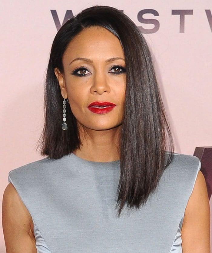 Thandie Newton rocks an asymmetrical long bob haircut with smokey eye-makeup and red lipstick