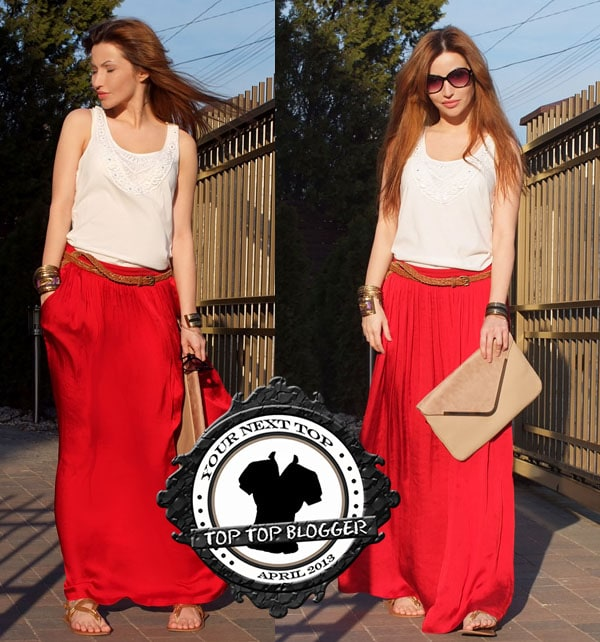 Tor wears a white shirt with a long red maxi skirt