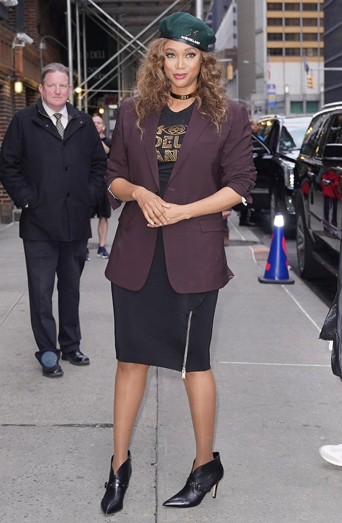 Tyra Banks trades her pantsuit for a zippered skirt as she arrives at The Late Show with Stephen Colbert