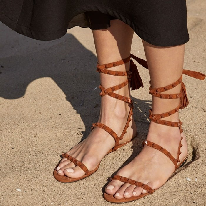 Iconic rockstuds line these breezy leather sandals styled with wrap ties and a mini stacked heel