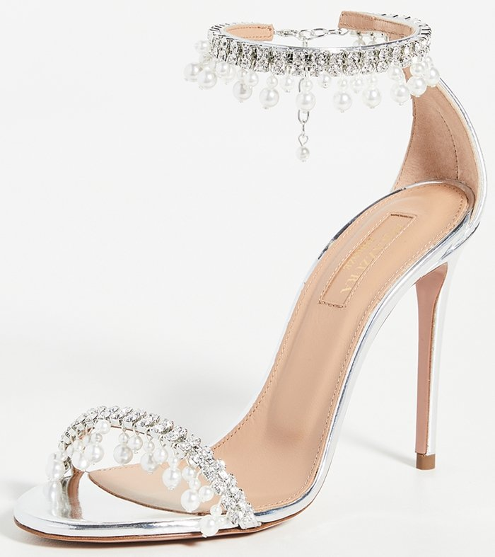 These sandals are decorated with clusters of faux pearls and crystals that move and sparkle with every step