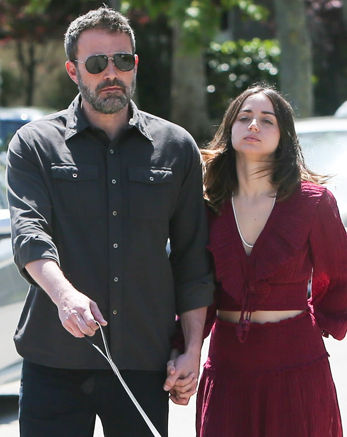 Ben Affleck wears a button-up shirt while Ana de Armas stuns in Zimmermann outfit