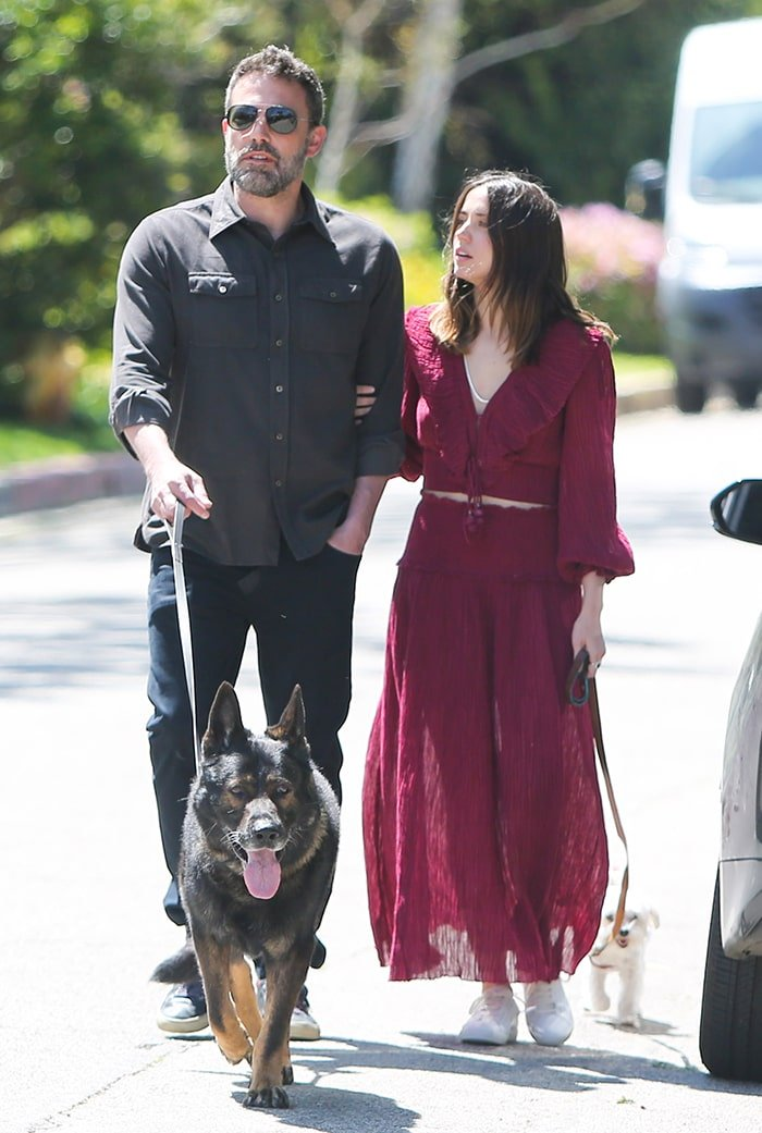 Ben Affleck and Ana de Armas arm-in-arm as they walk their dogs in Pacific Palisades on March 30, 2020