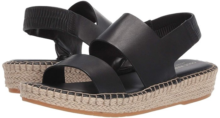 Ropes of braided jute wrap the low platform sole of a sandal styled for supreme comfort with signature cushioning in the footbed and a soft elastic heel strap